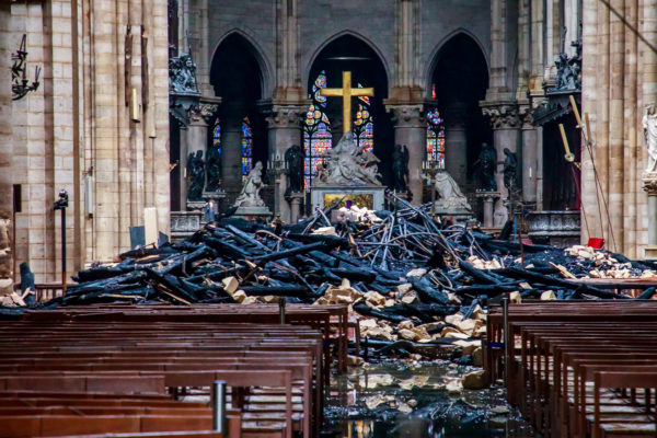 A view of the debris inside Notre-Dame de Paris in the aftermath of a fire that devastated the cathedral on April 16, 2019. Photo by Christophe Petit Tesson/Pool via Reuters