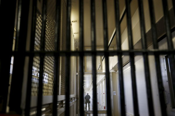 A guard stands behind bars at the Adjustment Center during a media tour of California's Death Row at San Quentin State Prison in California. Picture taken December 2015. Photo by Stephen Lam/Reuters