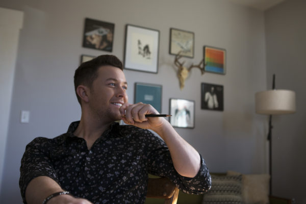 """The former """"American Idol"""" winner has a string of country hits, but was dropped by his label in 2016, a low point for the young country music star. But, from there, """"I just kept taking one step at a time,"""" he told the NewsHour. He released a new album last year. Photo by Jeff Ray"""