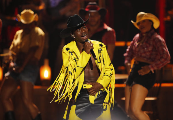 """Lil Nas X performs his hit single """"Old Town Road"""" during the 2019 Stanley Cup Final Party at Boston's City Hall Plaza in Boston on May 27, 2019. Photo by Nathan Klima for The Boston Globe via Getty Images"""