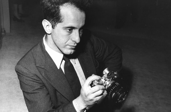 Robert Frank holding a pre-war Leica camera in 1954. Photo by Fred Stein Archive/Archive Photos/Getty Images