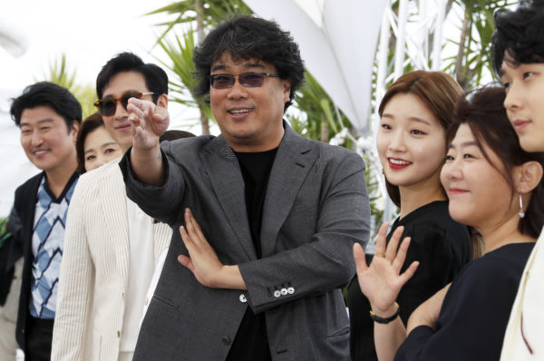 "FILE PHOTO: Bong Joon-ho, the director of the film ""Parasite"" poses with his team at the 72nd Cannes Film Festival on May 22, 2019. Photo by Eric Gaillard/Reuters"