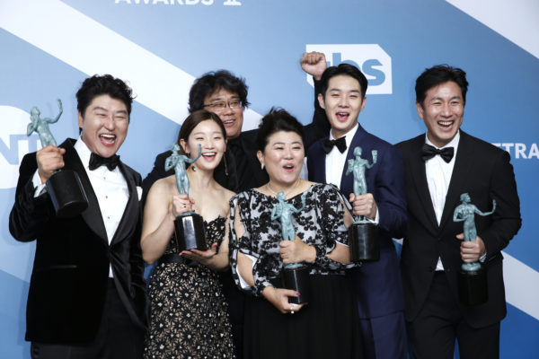 """The cast of """"Parasite"""" poses backstage with their Outstanding Performance by a Cast in a Motion Picture award at the 26th Screen Actors Guild Awards in Los Angeles on January 19, 2020. REUTERS/Monica Almeida"""