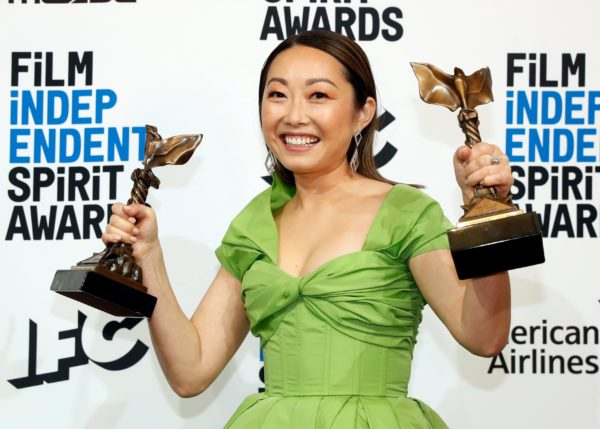 """Lulu Wang poses backstage with the award for Best Feature for the film """"The Farewell"""" and for Best Supporting Female which she accepted on behalf of Zhao Shuzhen, also for """"The Farewell."""" Photo by Lucas Jackson/Reuters"""
