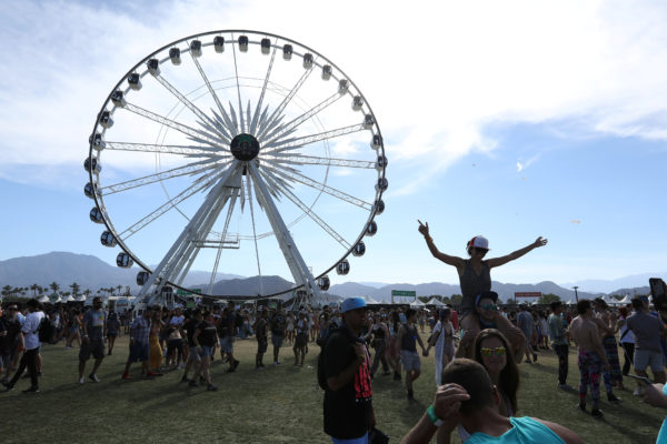 People pose for photos during the Coachella Valley Music and Arts Festival in Indio, California. Photo by Carlo Allegri/Reuters