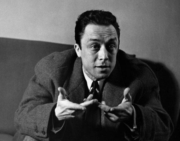 Albert Camus gestures in discussion. Photo by © Hulton-Deutsch Collection/CORBIS/Corbis via Getty Images